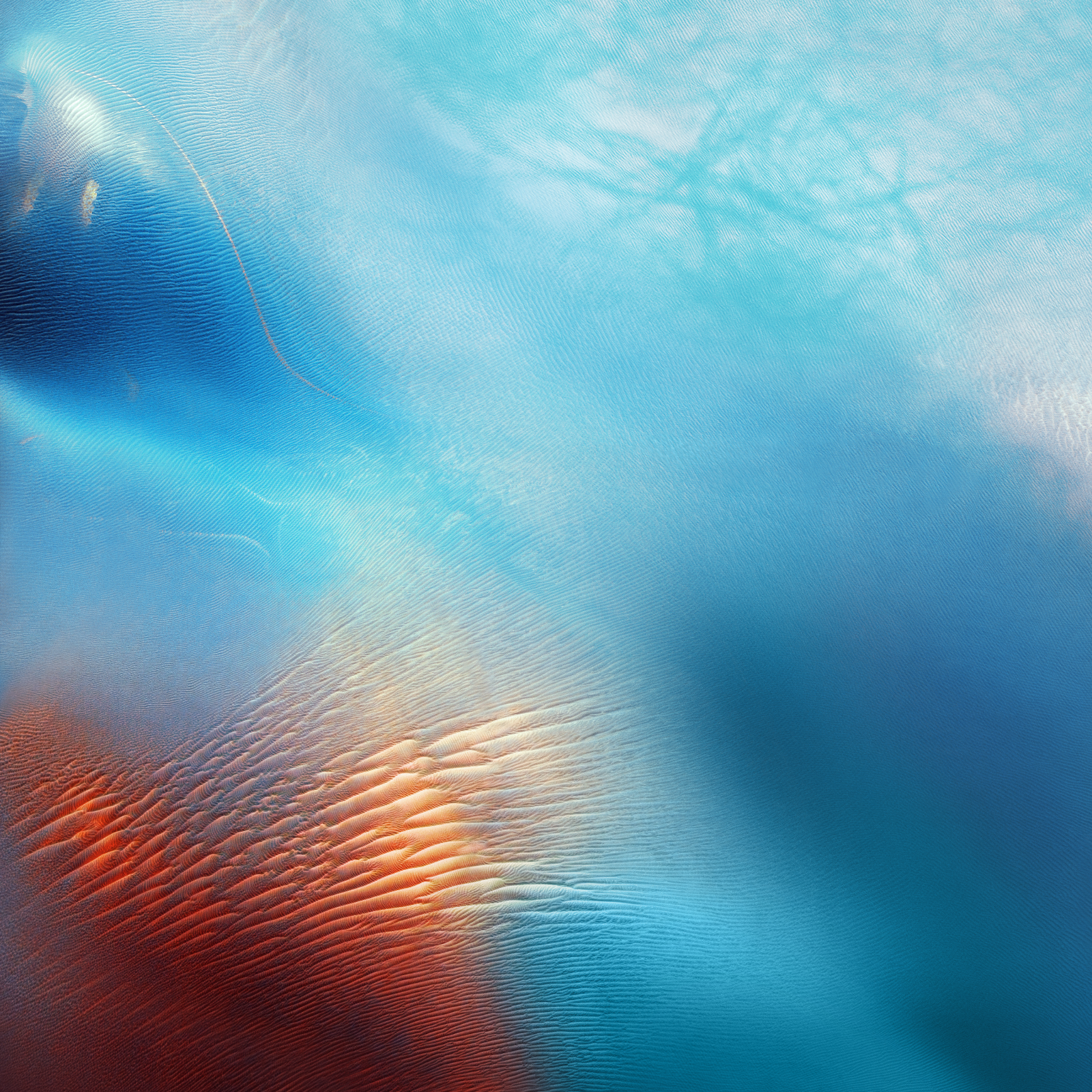 Change Your Wallpaper On The Fly In iOS 9